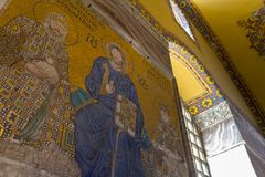 Mosaic of Virgin Mary and Jesus Christ and other Saints in the Hagia Sofia church royalty free stock photos