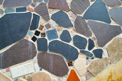Mosaic wall background. A decorative mosaic outside on the wall of a house - modern art Stock Photography