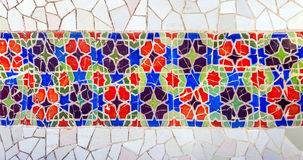 Mosaic wall Barcelona Gaudi. Mosaic wall at the Parc Guell designed by Antoni Gaudi located on Carmel Hill, Barcelona, Spain royalty free stock photos