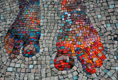 Mosaic wall. From ceramic tile,detail with foot royalty free stock photo