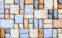 Mosaic wall design. A Wall roughly made with granite pieces Stock Photo