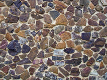 Mosaic wall lined with multi-colored natural stones Stock Photos