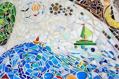 Mosaic on the wall made of broken colored tiles. Stock Photo