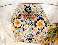 Mosaic wall at Parc Guell in Barcelona, Spain. Colorful ceramic tiles in Parc Guell Royalty Free Stock Photography