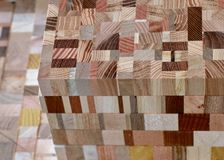 Mosaic wooden cube. Assembly of various pieces of wood Royalty Free Stock Photo