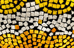 Mosaic in yellow and white. Yellow, orange and white mosaic with uneven rugged square pieces on a black background Royalty Free Stock Photography