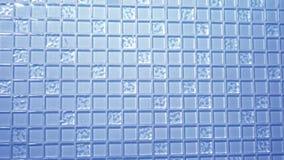 Mosaico azul do fundo da textura, telhas transparentes quadradas pequenas na parede Painel de vidro para cozinhas filme
