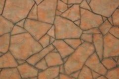 Mosaico delle pietre rosse della grande forma irregolare con i bordi grigi immagini stock