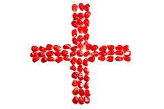 Mosaicos feitos de grões da romã sob a forma da cruz vermelha Fotos de Stock Royalty Free