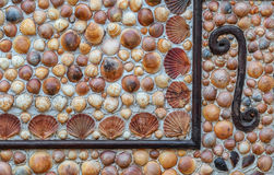 Mosaics made of seashells on a wall. Royalty Free Stock Photography