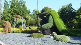 MOSAICULTURES-INTERNATIONAL 2013, MONTREAL BOTANISK TRÄDGÅRD, Quebec, Kanada, Montreal tillträde: Mannen som planterade träd Royaltyfri Bild