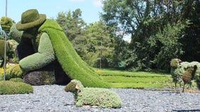 MOSAICULTURES-INTERNATIONAL 2013, MONTREAL BOTANISK TRÄDGÅRD, Quebec, Kanada, Montreal tillträde: Mannen som planterade träd Arkivbilder