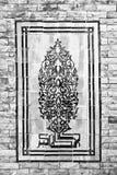 Mosaik auf der Backsteinmauer Stockfoto