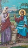 Mosaik av Jesus och barnsamaritkvinnan på brunnen fotografering för bildbyråer