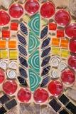 Mosaik mit Schneckenhäusern und Glasperlen Stockbilder