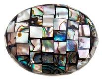 Mosaik på stenen från stycken av naturlig pärlemo Royaltyfri Fotografi