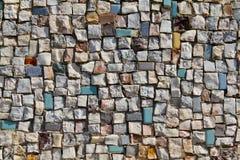 Mosaiken texturerar av lite stenväggen (närbilden) Fotografering för Bildbyråer
