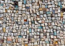 Mosaiken texturerar av lite stenväggen Royaltyfri Foto
