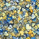 Mosaisk sömlös bakgrund för blåa gula hjärtor Arkivbilder