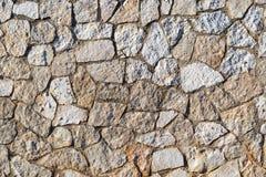 Mosaisk textur av en stenvägg Arkivbild