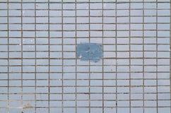 Mosaiska tegelplattor på fasaden av ett hus Arkivfoto