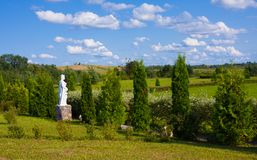Beautiful park wih sculptures near St. Anne`s Church in Mosar, Belarus, the site of the Jesuit. Mosar, Belarus - August 17, 2018: Beautiful park wih sculptures stock image