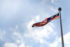 Mosca de la bandera nacional de Malasia Imagen de archivo libre de regalías