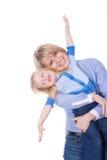 Mosca sonriente feliz de la mama y del niño Imágenes de archivo libres de regalías