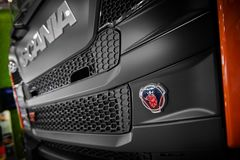 MOSCOW, APR, 18, 2018: Close up diagonal view on Scania G440 XT tipper truck logo on hood radiator. Swedish car logotype. Special stock image
