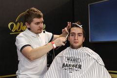 Barber cuts a man royalty free stock images