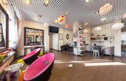 MOSCOW - APRIL 2015: Interior of luxury beauty salon Philosofiya Stilya. The main hall Stock Photos