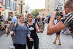 Lovely women posing in front of the camera walking around the city stock images