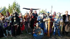 Moscow Area, RUSSIA - August 22, 2018: Cosplayers showing Warhammer armored warrior character costume for role-playing stock video footage