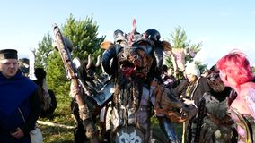 Moscow Area, RUSSIA - August 22, 2018: Cosplayers showing Warhammer armored warrior character costume for role-playing. Moscow Area, RUSSIA - August 22, 2018 stock video