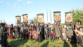Moscow Area, RUSSIA - August 22, 2018: Cosplayers showing Warhammer armored warrior character costume for role-playing stock footage