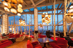 A half-empty restaurant Sixty Stock Image