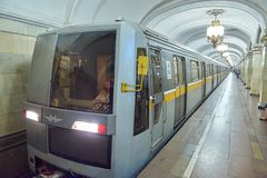 MOSCOW, AUG, 22, 2017: Modern cube style subway passenger grey train at metro station. Perspective front view of train cabin. Russ. Ian railway metro train royalty free stock image