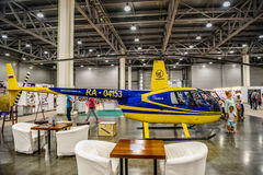 MOSCOW - AUG 2016: Robinson R44 helicopter presented at MIAS Moscow International Automobile Salon on August 20, 2016 in Moscow, R. Ussia Stock Image