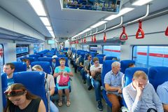MOSCOW, AUG.29, 2018: View on seating people in the passenger train saloon on new Moscow Ring Railway line. Passengers inside a tr royalty free stock images