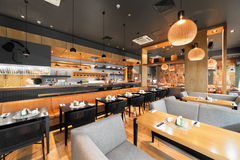 MOSCOW - AUGUST 2014: Interior of a Japanese restaurant bar and lounge. `KABUKI` The main hall with a open kitchen and a long leather sofa along the tables Stock Photo