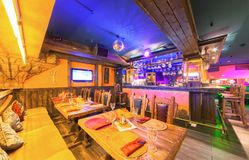 MOSCOW - AUGUST 2014: Interior of the Mexican nightclub restaurant. `SOMBRERO`. Wooden table near the bar counter stock photography