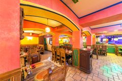 MOSCOW - AUGUST 2014: Interior of the Mexican nightclub restaurant. `SOMBRERO`. Hall with a restaurant with wooden furniture stock photography