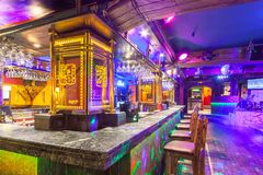 MOSCOW - AUGUST 2014: Interior of the Mexican nightclub restaurant. `SOMBRERO`. Bar counter with bar stools near the dance floor royalty free stock image