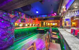 MOSCOW - AUGUST 2014: Interior of the Mexican nightclub restaurant. `SOMBRERO`. Bar counter nightclub near the dance floor with backlight and light chaser stock photos