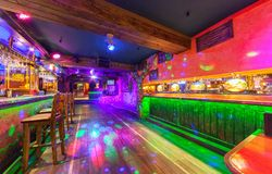 MOSCOW - AUGUST 2014: Interior of the Mexican nightclub restaurant. `SOMBRERO`. An empty dance floor near bar with backlight and light chaser royalty free stock image