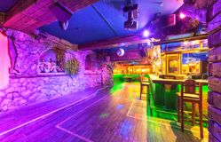 MOSCOW - AUGUST 2014: Interior of the Mexican nightclub restaurant. `SOMBRERO`. An empty dance floor near bar with backlight and light chaser royalty free stock photos