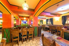 MOSCOW - AUGUST 2014: Interior of the Mexican nightclub restaurant. `SOMBRERO`. Hall with a restaurant with wooden furniture royalty free stock photography