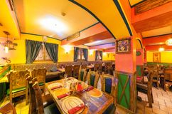 MOSCOW - AUGUST 2014: Interior of the Mexican nightclub restaurant. `SOMBRERO`. Hall with a restaurant with wooden furniture stock image