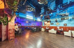 MOSCOW - AUGUST 2014: Interior of the night club. `PIRAT`. Dance floor with lighting and sound equipment on the ceiling royalty free stock images