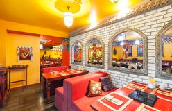 MOSCOW - AUGUST 2014: The interior of the restaurant Indian and Tibetan cuisine and is decorated in ethnic style Stock Photos